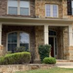 Texas two story house front porch with gutters