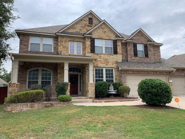 Two story brick house with gutters