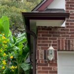 Brown gutters on red brick house